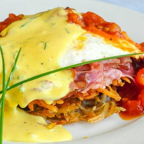 Tomato Eggs Benedict with Potato lakes and Prosciutto