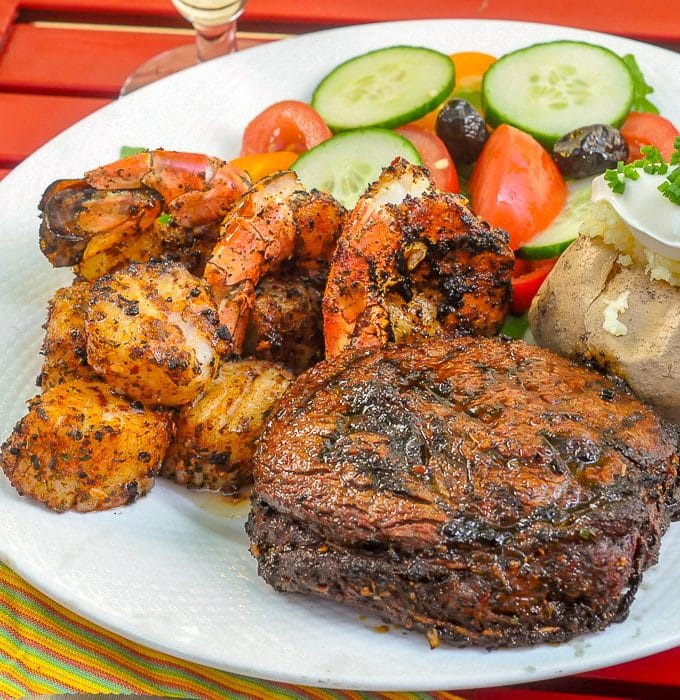 Cajun Spice Rub on Surf and Turf shown with baked potato and salad