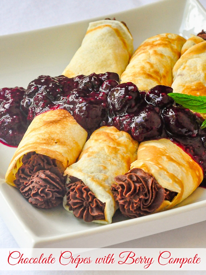 Chocolate Crepes with mixed berry compote photo with title text added for Pinterest