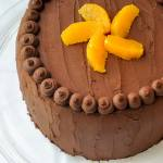 Orange Cake with Easy Chocolate Truffle Frosting - a butter based, old fashioned scratch cake, filled with layers of easy, melt in your mouth chocolate truffle frosting.