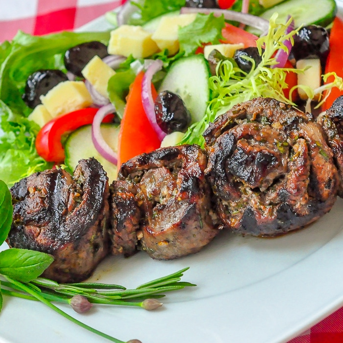 Herb and Garlic Rolled Steak Medallions close up photo