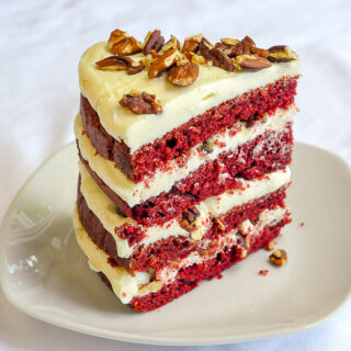 One slice of red velvet cake on a white plate