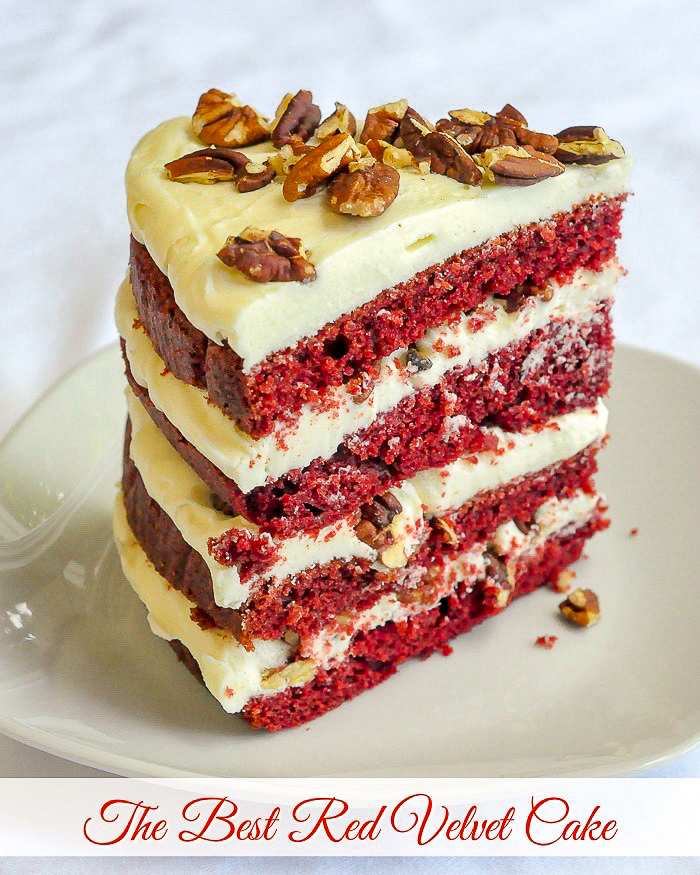 The Best Red Velvet Cake photo of one slice with title text added for Pinterest