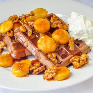 Chocolate Caramel Walnut Banana Waffles close up image on white plate