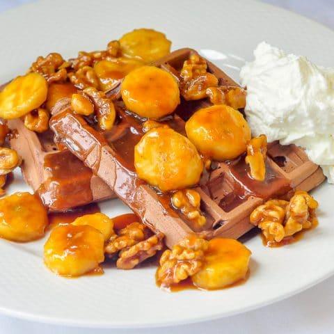 Chocolate Caramel Walnut Banana Waffles close up image on white plate