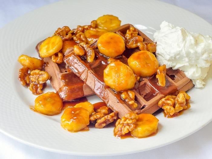 Chocolate Caramel Walnut Banana Waffles wide shot of whole serving on white plate