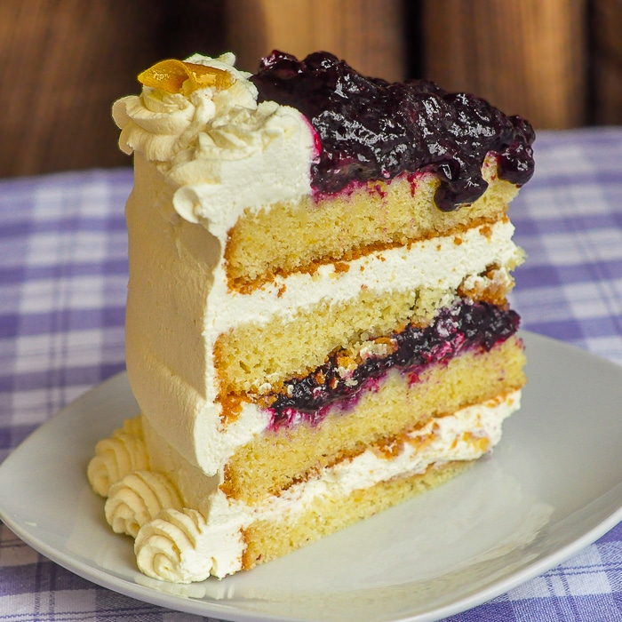 Lemon Blueberry Cream Cake photo of a single slice on a white plate