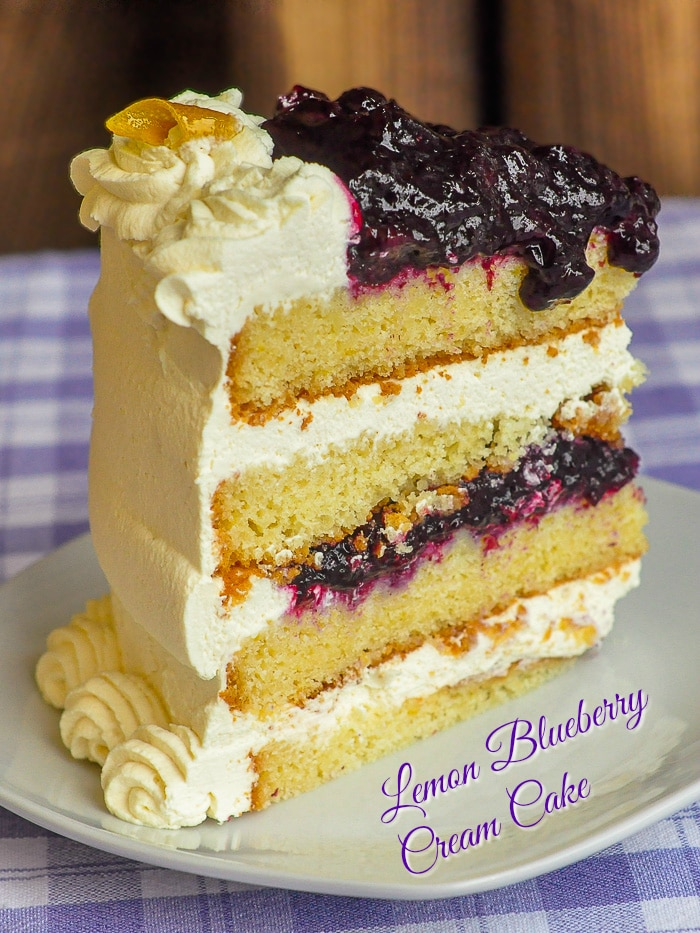 Lemon Blueberry Cream Cake photo of a single slice with title text added for Pinterest