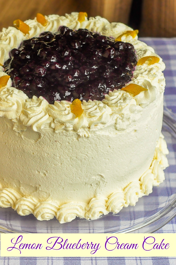 Lemon Blueberry Cream Cake photo of uncut cake with title text added for Pinterest