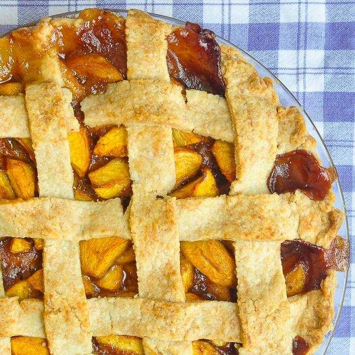 Peach pie overhead close up photo of uncut pie