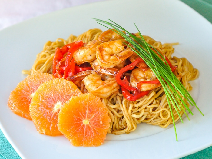 15 Minute Orange Hoisin Shrimp & Noodles wide shot photo of single serving on a white plate