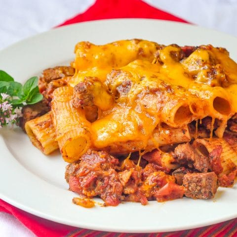 Cheesy Steak & Bacon Baked Pasta closw up image of single serving on a white plate