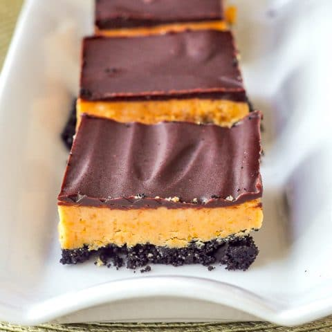 Oreo Peanut Butter Bars close up image on white serving plate