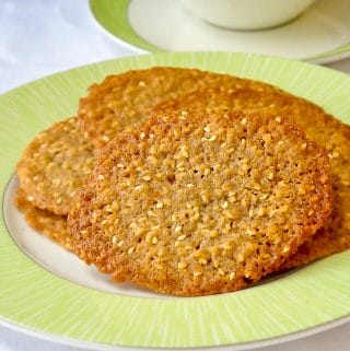 Sesame Wafer Cookies on a white plate with tea on the side