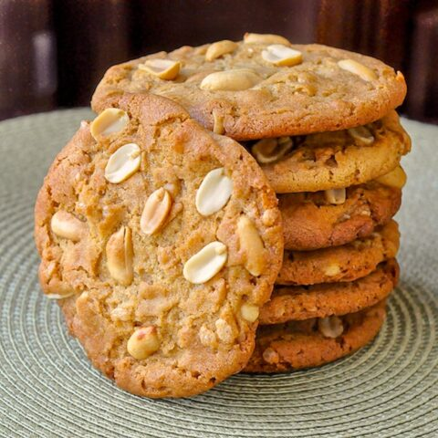 Peanut Butter Crunch Cookies photo of stack of cookies on a green placemat
