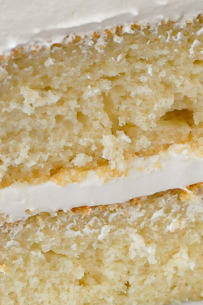 White Velvet Cake close up photo of one slice showing the moist crumb structure