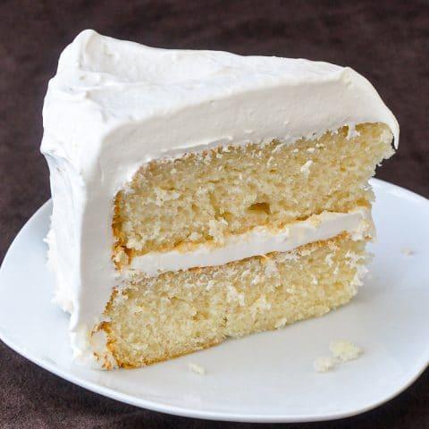 White Velvet Cake photo of a single slice on a white plate