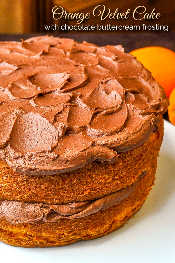 photo of uncut Orange Velvet Cake with title text added for Pintertest