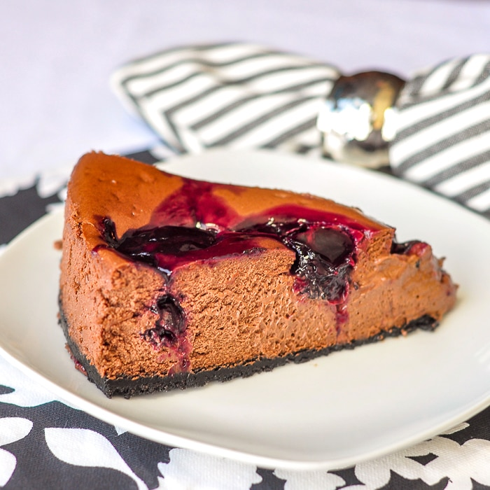 Chocolate Cherry Swirl Cheesecake photo of single serving on a white plate