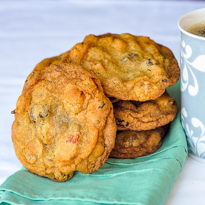 Crispy Chewy Apricot Raisin Cookies shown with coffee cup and napkin