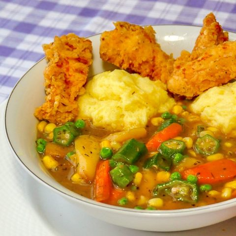 Fried Chicken Stew showing a single serving in a white bowl
