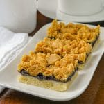 Blueberry Crumble Bars shown on a white plate.