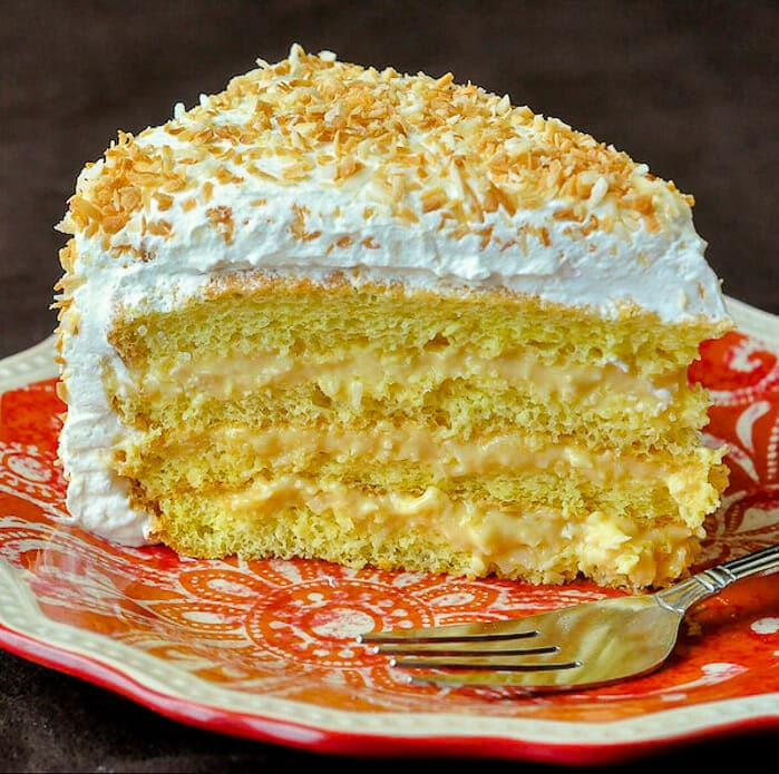 Coconut Cream Cake showing a cut slice.