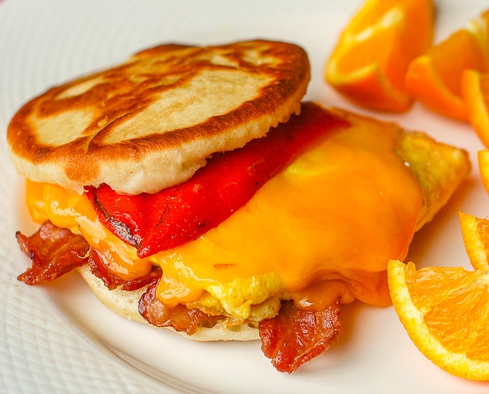 Touton Breakfast Sandwich with egg , bacon, cheese and roasted red pepper.