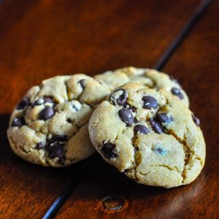 The Best Peanut Butter Chocolate Chip Cookies photo of 3 cookies on a wooden table top