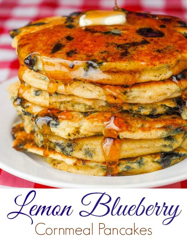 Blueberry Lemon Cornmeal Pancakes. Breakfast heaven! These blueberry cornmeal pancakes with a lemon twist are some of the lightest & best ever. The cornmeal makes the edges extra crispy too. #breakfast #brunch #pancakes #lemon #blueberry