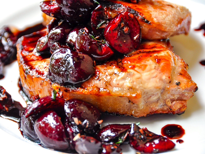Close up photo of Grilled Pork Chops with Balsamic Thyme Cherries