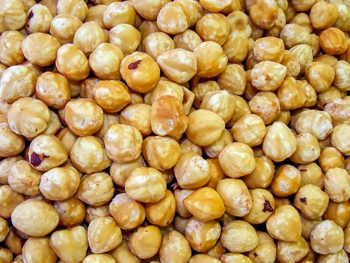 Close up of toasted hazelnuts stock photo