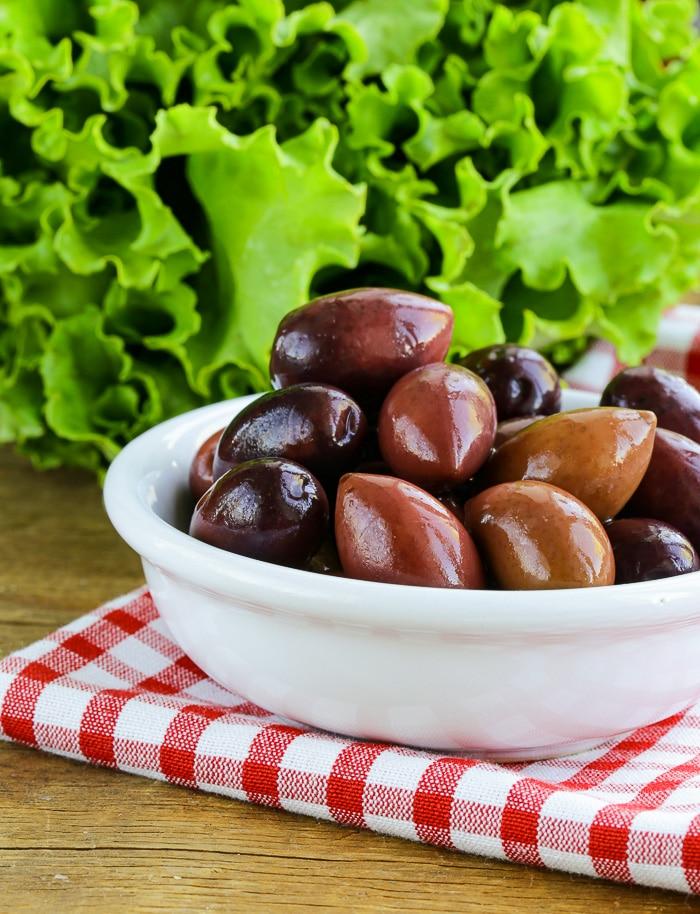 Kalamata Olives in a white bowl.