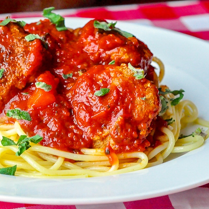 Low Fat Smoky Barbecue Turkey Spaghetti and Meatballs close up image on white plate