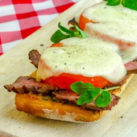 Open Face Tomato Provolone Steak Sandwich close up square cropped feature image