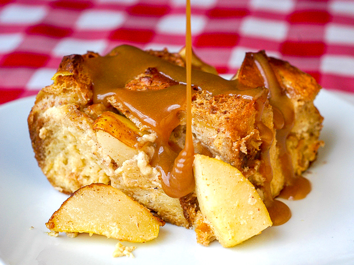 Spiced Pear Bread Pudding photo with butterscotch sauce being pored on
