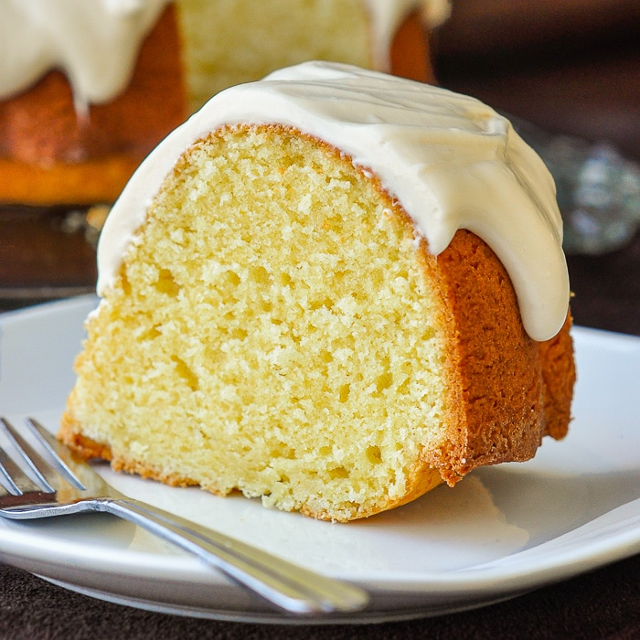 Vanilla Cream Cheese Bundt Cake close up photo of a single slice on a white plate