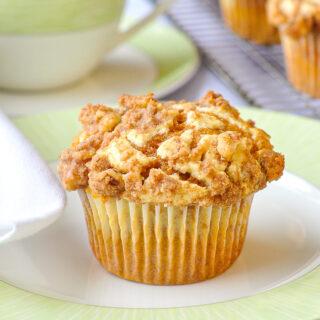 Close up photo of Pumpkin Cream Cheese Walnut Streusel Muffins