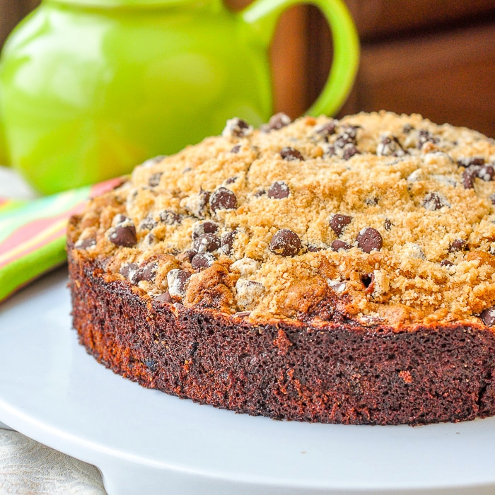 Date Coffee Cake with Chocolate Chip Streusel image of whole cake on white serving plate