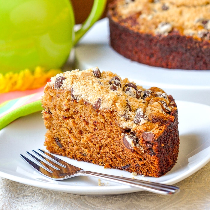 Date Coffee Cake with Chocolate Chip Streusel photo of single slice on a white plate