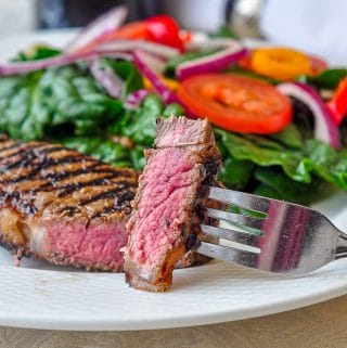 Dijon Balsamic Marinated Steak close up of cut steak showing perfect medium rare centre
