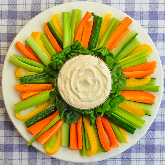 Low Fat Chipotle Ranch Dip with vegetables on a white serving platter.