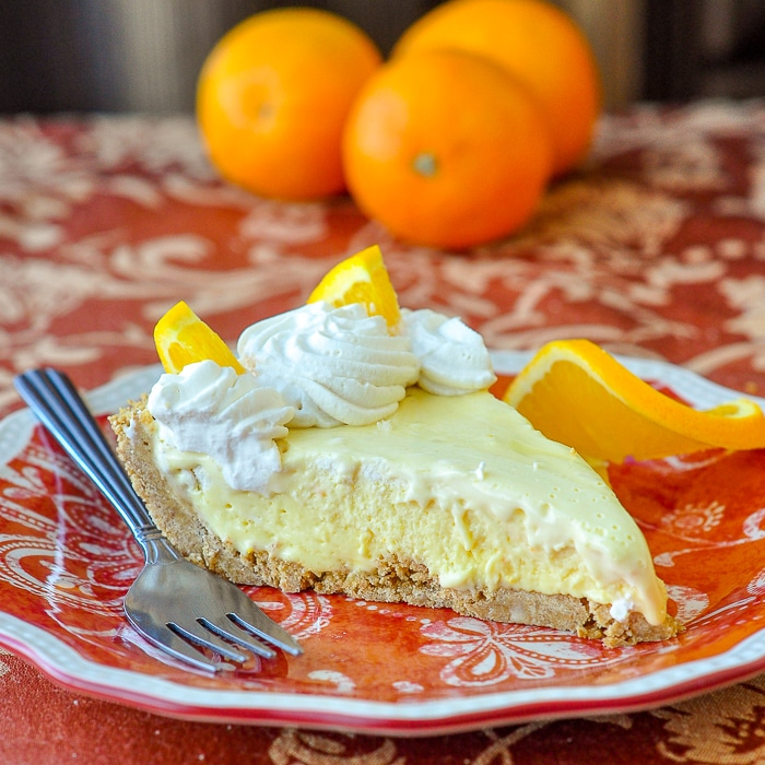 Orange Creamsicle Pie photo of single slice on orange patterned plate