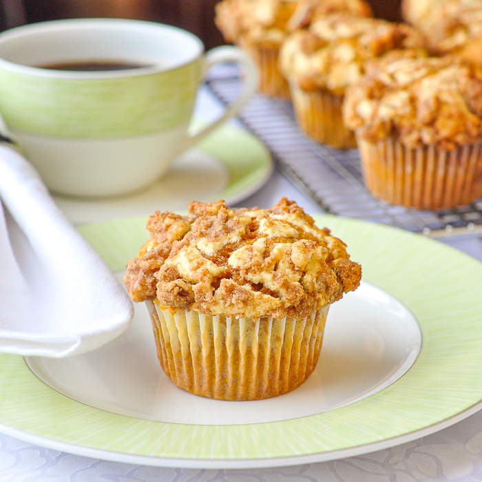 Pumpkin Cream Cheese Walnut Streusel Muffins with green coffee service in the background