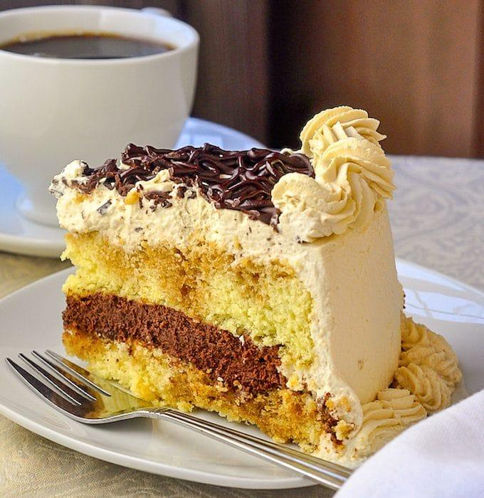 Chocolate Filled Kahlua Tiramisu Cake close up photo of a single slice on a white plate