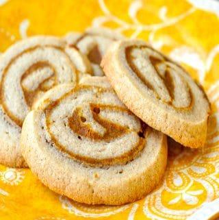 Pumpkin Pie Pinwheel Cookies close up of cookies on a yellow plate