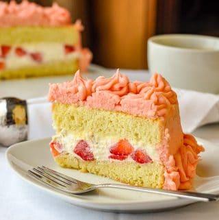 https://www.rockrecipes.com/wp-content/uploads/2013/03/Strawberry-Mascarpone-Cream-Cake-close-up-photo-of-single-slice-on-a-white-plate.jpg