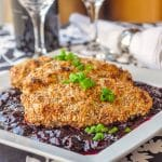 Almond Chicken with Sweet and Sour Cherry Sauce shown on white serving platter
