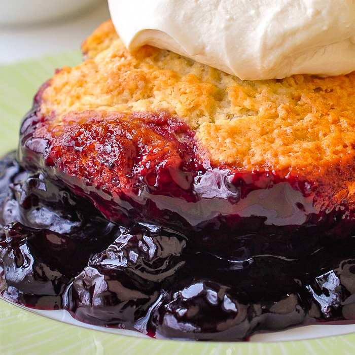 Close up photo of the cherry sauce underneath the cherry cobbler