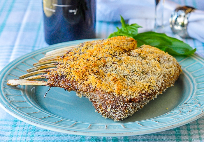 Parmesan Panko Crusted Rack of Lamb photo of completely cooked uncut rack of lamb